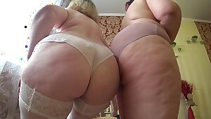 Voluptuous foreplay of two mature lesbians with chubby asses, gradual undressing and caress.