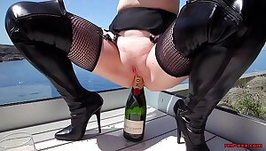 Grown up Red XXX fucks a champagne bottle outside