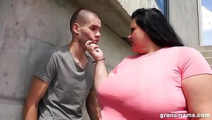 Hulking of age gets her ass licked and deep throats young stud