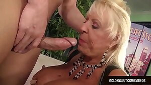 Busty Grandma Mandi McGraw Sucks a Weasel words and Then Rides It adjacent to Enthusiasm